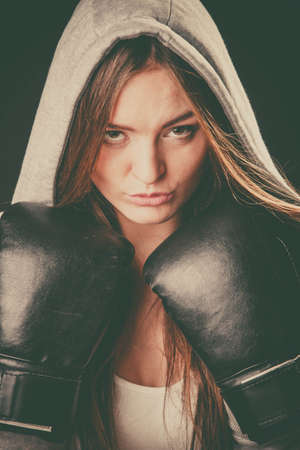 intimidating: Exercising prepare for fight. Sportsmanship and strong body. Young woman wear sportswear boxing with opponent. Sport and fitness healthy lifestyle.