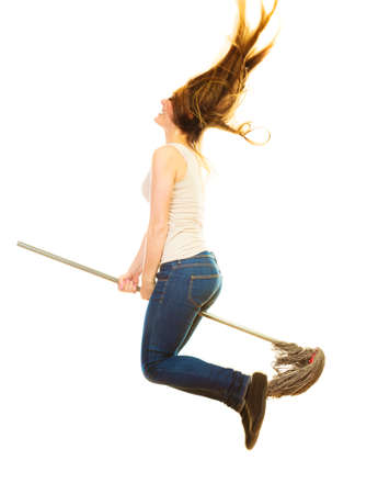 charwoman: Cleanup housework concept. Funny cleaning lady young woman mopping floor, holding mop jumping flying on white background Stock Photo