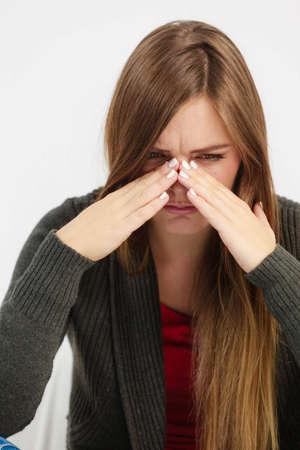 anguish: Sinus ache causing very paintful headache. Unhealthy woman in pain. Sharp strong sore.