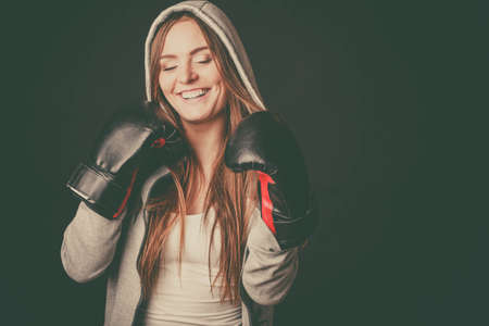 sportsmanship: Exercising prepare for fight. Sportsmanship and strong body. Happy young woman wear sportswear boxing with opponent. Sport and fitness healthy lifestyle.