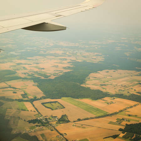birds eye: Birds eye. View from window of plane airplane flying over Poland Europe.