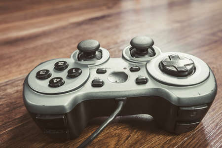 xbox: Playing games concept. Single pad joystick controller on floor. Stock Photo