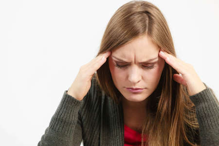 health concern: Very paintful headache. Unhealthy woman in pain. Sharp strong sore. Stock Photo