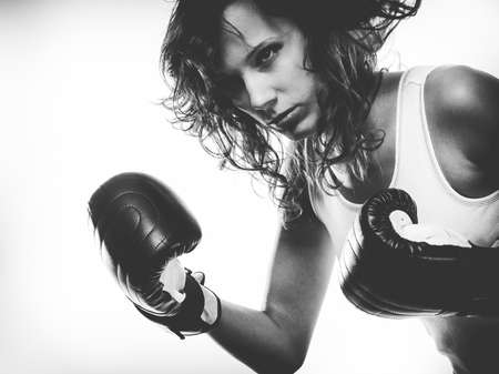 fairplay: Sportsmanship fairplay and strong body. Young woman fighting boxing with opponent. Sport and fitness healthy lifestyle exercising. Black & white Stock Photo