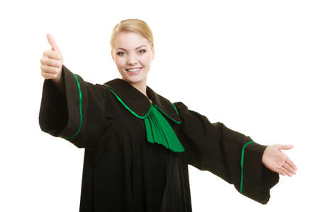 judicature: Law court or justice concept. woman lawyer attorney in classic polish black green gown making welcome inviting gesture ok hand sign isolated Stock Photo