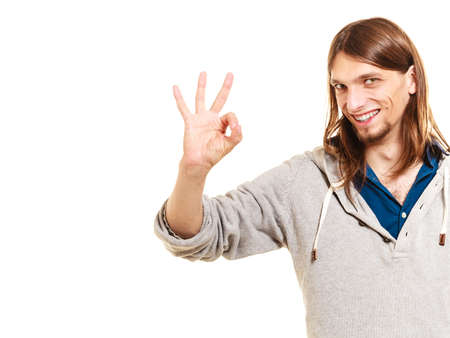 alright: Man showing ok fine alright gesture. Isolated on white background.