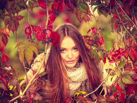 Fall lifestyle concept, harmony freedom. Beauty young woman fashion girl relaxing walking in autumnal park, outdoor