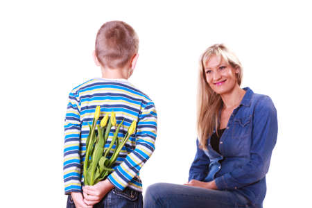 special occasions: Special occasions holiday and mother day. Young boy prepare surprise gift flowers hold tulips behind back mother sit smiling.