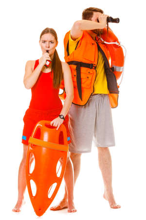 float tube: Lifeguards with rescue tube ring buoy lifebuoy and life vest jacket looking through binoculars. Man and woman supervising swimming pool whistling. Accident prevention.
