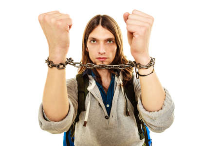 imprisoned: Young man guy slave imprisoned tied with chained hands.