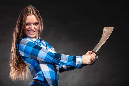 machete: Pretty gorgeous woman holding machete. Strong girl feminist wearing checked shirt.