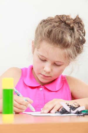 crayon  scissors: Little girl draw in the classroom. Being creative in elementary age