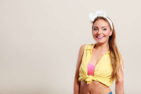 hairband: Alluring seductive pretty pin up girl with hairband bow. Attractive gorgeous young retro woman posing in studio.