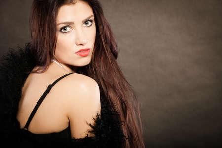 ladylike: Magnificent long hair woman red lipstick black dress portrait on dark Stock Photo