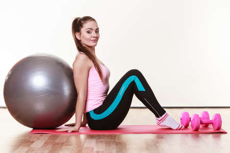 fit ball: Girl with training equipment. Young female in gym with fit ball. Activity fitness health workout concept. Stock Photo