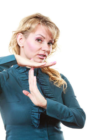 interruption: Break time. Blonde middle aged business woman showing interruption symbol. Elegant female employee with hands gesture isolated on white. Dumb communication.