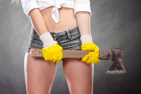 axe girl: Closeup of sexy woman holding axe chopper. Strong girl feminist working in man profession. Independent female. Stock Photo