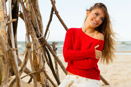 spending full: Rest and relax. Beauty young girl full of happiness spending time outdoor on seaside. Portrait of happy smiling woman on beach.