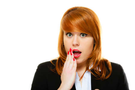 wide eyed: Emotional facial expression wide eyed business woman surprised girl open mouth covering her mouth with hand isolated on white Stock Photo