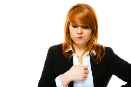 doubtfulness: Portrait of funny redhair business woman or student girl full of doubts and hesitation. Studio shot isolated on white background