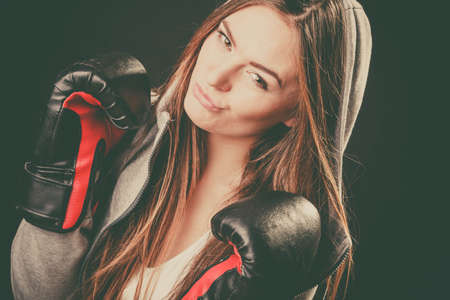 intimidating: Exercising prepare for fight. Sportsmanship and strong body sport and fitness healthy lifestyle. Young woman wear sportswear boxing with opponent.