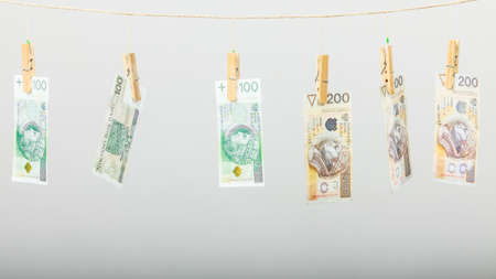 debt collection: Banknotes cash money hang on laundry line on gray grey background.