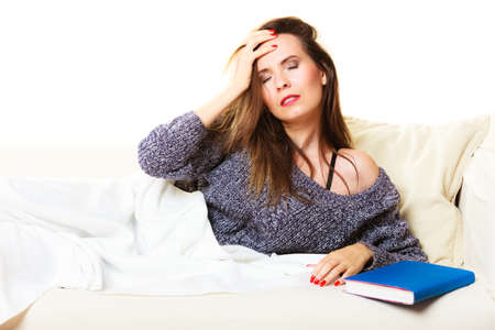 power nap: Health balance sleep deprivation concept. Woman lying on couch suffering from head pain taking power nap