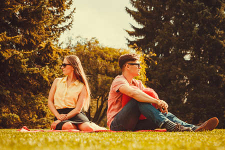 dissapointed: Love romance heartbreak concept. Moody girl with boyfriend in park. Lady upset on her man. Stock Photo