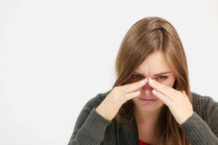 Sinus ache causing very paintful headache. Unhealthy woman in pain. Sharp strong sore.
