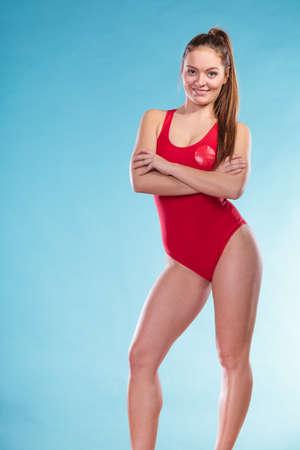 Portrait of happy joyful lifeguard lifesaver woman girl on blue. Accident prevention rescue.