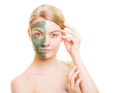 mud girl: Skin care. Woman in clay mud mask on face isolated on white. Girl taking care of dry complexion. Beauty treatment. Stock Photo