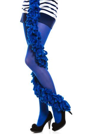 legs around: Female fashion. Woman long legs blue stockings high heels and warm scarf around leg isolated Stock Photo