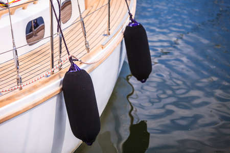 hull: Yachting. Sailboat in the sea different parts of yacht. Side of hull with black fenders