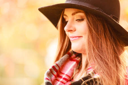checkered scarf: Autumn season people concept. Portrait of attractive woman. Beautiful lady wearing black hat and checkered scarf.
