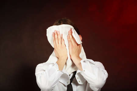 masculinity: Serving masculinity job concept. Tired waiter wiping his face. Exhausted bartender cleans his head with rag. Stock Photo