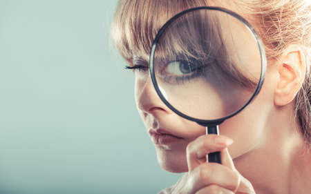 lupa: Investigation exploration education concept. Closeup funny woman face, girl holding on eye magnifying glass loupe