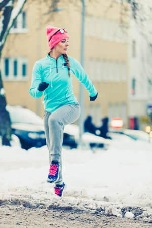 staying fit: Woman maintaining fitness in winter. Staying fit despite cold and ice, fashion health concept