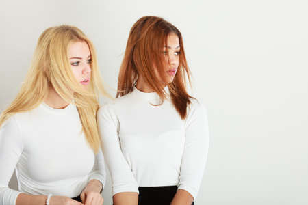 mulatto: People colleagues concept. Blonde and dark friends together. Bright girl posing with mulatto lady.