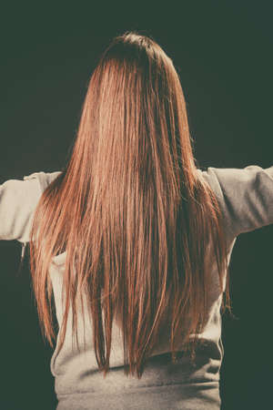 outstretched hand: Pulling sides embracing spread arm. Girl stand backwards show back casual clothes long hair, Outstretched hand shoulders only,