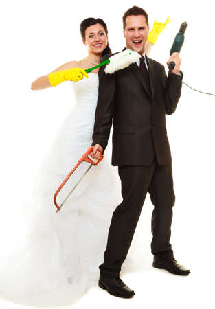 domestic chores: Housework concept. Humorous funny couple bride groom in domestic role, sharing household chores. Isolated on white background.