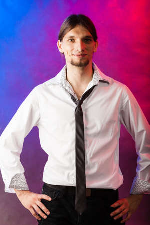 masculinity: Masculinity fashion party concept. Man in shirt and tie. Young long haired male on bright colorful background. Stock Photo