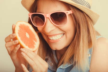 glad: Happy glad woman tourist in straw hat drinking grapefruit juice. Healthy diet food. Weight loss. Summer vacation holidays. Instagram filtered.