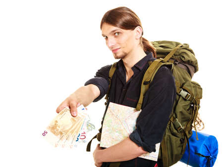 spendthrift: Man tourist backpacker paying with euro money holding map. Young guy hiker backpacking. Summer vacation travel. Isolated on white background.