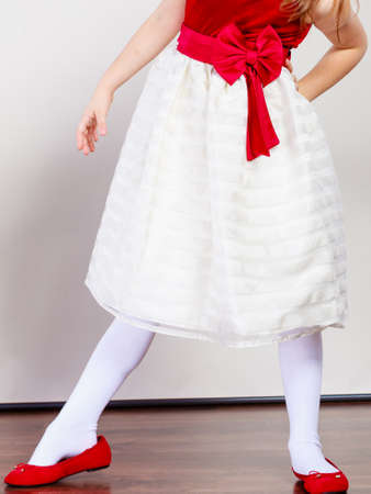 ballerina tights: Part body girl wearing beutiful princess fairy dress. Little child in ballerina clothes indoor.
