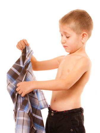 Childhood independence concept - little boy dressing up Banque d'images