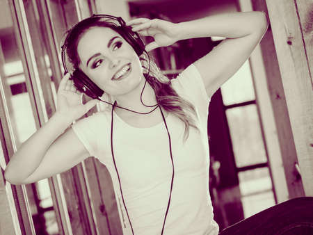 dance time: Hobby music expression and free time. Young girl listen music dance with hands on headphones. Stock Photo
