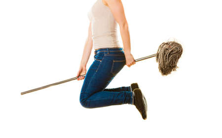 hag: Cleanup housework concept. Funny cleaning lady young woman mopping floor, holding mop jumping flying on white background Stock Photo