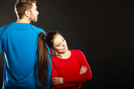 insulted: Offended upset young couple not talking to each other standing back to back after argument quarrel. Unhappy man and woman. Disagreement in relationship. Stock Photo