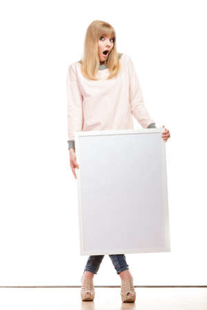 blank expression: Advertisement concept. woman emotional face expression full body with blank presentation board. Female model showing banner sign copy space. Isolated