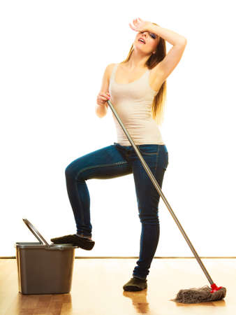 fed up: Spring cleaning despair concept. Tired woman mopping floor. Girl upset and fed up about housework white background